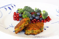 Vegetarian food. Vegetable cutlets from red lentils, onions, parsley and oatmeal. With salad of broccoli, pomegranate seeds and bl. Ueberries a variety of stock photo