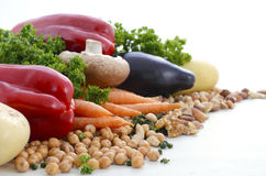 Vegetarian food vegetables, nuts and legumes. Vegetarian food including vegetables, nuts and legumes with copy space on white background Royalty Free Stock Images