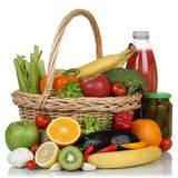 Vegetarian fruits, vegetables and drinks in a shopping basket. Isolated on a white background Royalty Free Stock Image
