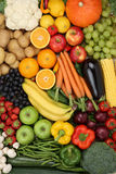 Vegetarian fruits and vegetables like apple, orange background Stock Photos