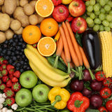 Vegetarian fruits and vegetables like apples, oranges and tomato Stock Image