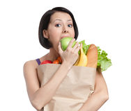 Vegetarian girl eats an apple Royalty Free Stock Photo