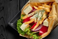 Vegetarian gyro in pita with vegetables and tzatziki. Greek cuisine dish. healthy fast food. Close up. Vegetarian gyro in pita with vegetables and tzatziki stock images