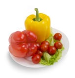 Vegetarian health food, Fresh vegetables. On white plate royalty free stock images