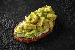 Vegetarian Healthy bread toasts with cottage cheese and avocado stock photography