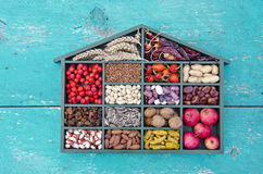 Vegetarian healthy fruits, seeds and dried food ingredient in wooden box Royalty Free Stock Photos