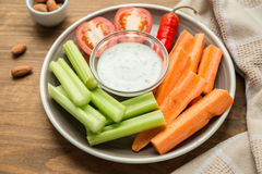 Vegetarian healthy snacks, vegetable snack: carrots, celery, tom Royalty Free Stock Image