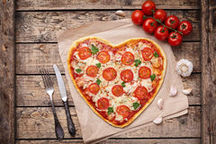 Vegetarian heart shaped pizza margherita with Stock Images