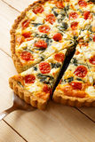 Vegetarian homemade pie, Quiche with tomatoes, spinach and feta cheese. Royalty Free Stock Photos