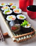 Vegetarian homemade sushi with avocado, tomato, peppers and lettuce. Stock Images