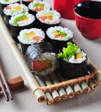 Vegetarian homemade sushi with avocado, tomato, peppers and lettuce. Royalty Free Stock Images