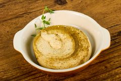 Humus. Vegetarian Humus with sesame seeds and thyme leaves Stock Photography