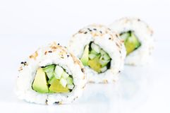 Vegetarian insideout rolls against white background. Some vegetarian insideout rolls against white background Royalty Free Stock Images