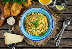 Vegetarian Italian Pasta Spaghetti Aglio E Olio with garlic bread, red chili flake, parsley, parmesan cheese and glas of Stock Images