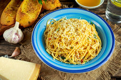 Vegetarian Italian Pasta Spaghetti Aglio E Olio with garlic bread, red chili flake, parsley, parmesan cheese and glas of Royalty Free Stock Images