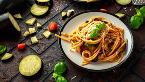 Vegetarian Italian Pasta Spaghetti alla Norma with eggplant, tomatoes, basil and parmesan cheese. Vegetarian Italian Pasta Spaghetti alla Norma with eggplant royalty free stock photography