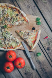 Vegetarian italian pizza on wodden table. Royalty Free Stock Images