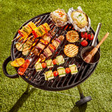 Vegetarian Kebabs and Vegetables Cooking on Grill Royalty Free Stock Photos