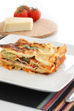 Vegetarian Lasagna. With eggplant, courgette, sweet potatoes and tomato sauce on a white plate Royalty Free Stock Photography