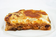Vegetarian Lasagna. On white plate stock photography