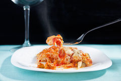 Vegetarian lasagna (front view). Vegetarian lasagna front view with glass in the background royalty free stock photos