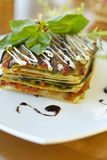 Vegetarian lasagna with tomato and pesto sauces Stock Images