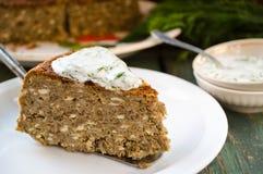 Vegetarian lentil-mushroom pie and yogurt dip with dill Stock Image