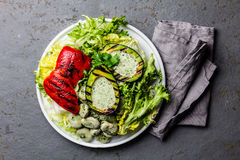 Vegetarian lettuce beans salad with grilled avocado and bell pepper. Top view Stock Photography