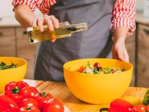 Vegetarian lifestyle woman cooking dressing salad stock photography
