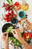 Vegetarian low calorie Greek salad preparation top view Royalty Free Stock Photography