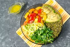 Vegetarian lunch bowl with beans mung and fresh vegetables. Vegetarian lunch bowl with beans mung, avocado, leek, cherry tomatoes, corn lettuce on gray Royalty Free Stock Photos