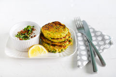Vegetarian lunch of zucchini fritters with coconut yogurt Royalty Free Stock Photos