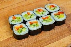 Vegetarian maki roll. With cucumber stock photo