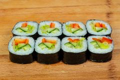 Vegetarian maki roll. With cucumber stock images
