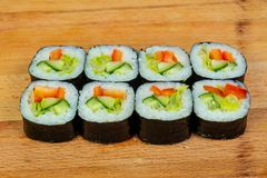 Vegetarian maki roll. With cucumber royalty free stock photography