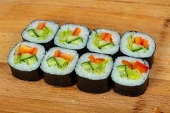 Vegetarian maki roll. With cucumber royalty free stock photo