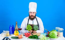Vegetarian. Mature chef with beard. Healthy food cooking. Chef man in hat. Secret taste recipe. Dieting and organic food stock images