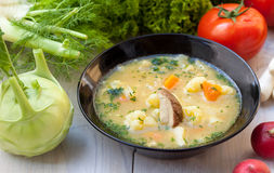 Vegetarian meal. Mushroom soup with fresh vegetables Stock Photo