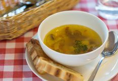 Vegetarian mushroom soup with vegetables and bread in white plat Stock Image