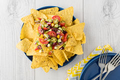 Vegetarian nachos with salsa and sour cream dips Stock Images