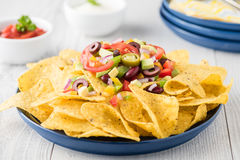 Vegetarian nachos with salsa and sour cream dips Stock Photography