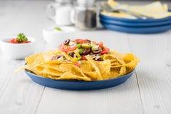 Vegetarian nachos with salsa and sour cream dips Stock Photos