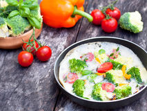 Vegetarian omelette with broccoli cherry tomato orange pepper an Stock Images