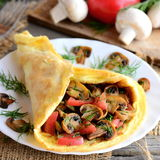 Vegetarian omelette idea. Fried mushrooms omelette with tomatoes and dill on a plate. Fresh mushrooms, tomatoes, dill Stock Image