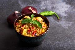 Vegetarian paneer biryani at black background. Paneer biryani is traditional veg indian cuisine dish with paneer cheese, basmati rice, masala, chili pepper stock photography