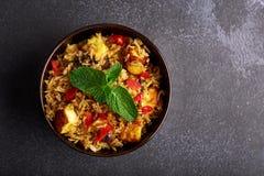 Vegetarian paneer biryani at black background. Paneer biryani is traditional veg indian cuisine dish with paneer cheese, basmati rice, masala, chili pepper royalty free stock photography