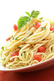 Vegetarian pasta. Wonderfully large serving of meatless pasta with fresh tomatoes and basil Royalty Free Stock Images