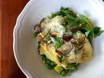 Vegetarian pasta dish with peas, leeks, basil, microgreens and cheese Stock Photo