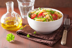 Vegetarian pasta fusilli with tomato peas herbs Stock Images