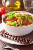 Vegetarian pasta fusilli with tomato peas herbs Stock Photography